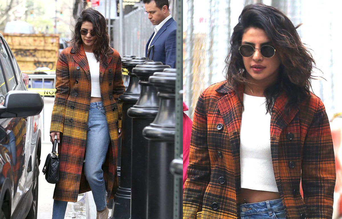 Priyanka-chopra-showed-off-her-piercing-while-sporting-a-cropped-white-top-with-jeans,-adding-a-plaid-multi-hued-coat-on-Monday-in-the-Big-Apple